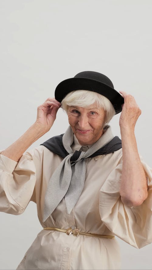 Fashionable Old Woman Posing for Camera
