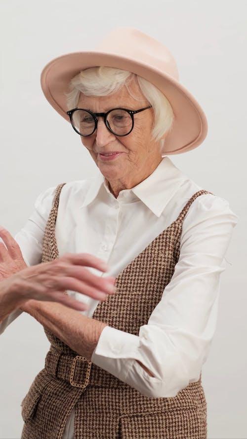 Elderly Fashionable Woman Posing for Camera