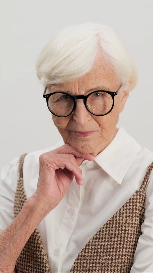 Stylish Old Woman Posing with Hand on Chin