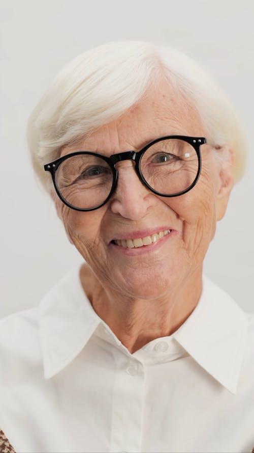 Headshot of Cheerful Old Aged Woman
