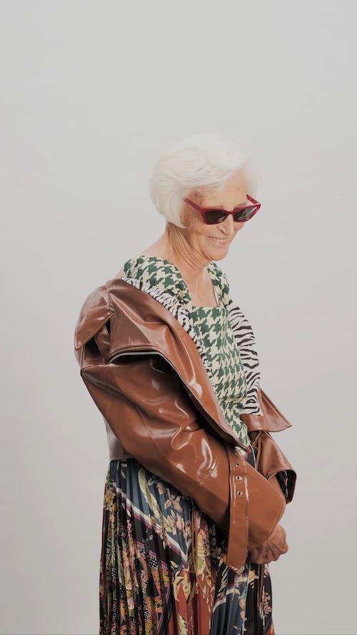 Stylish Elderly Woman Posing for Camera