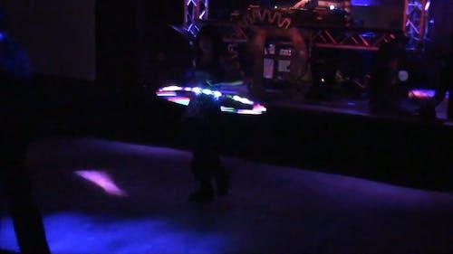 Girl Dancing with Led Hula Hoop at a Club