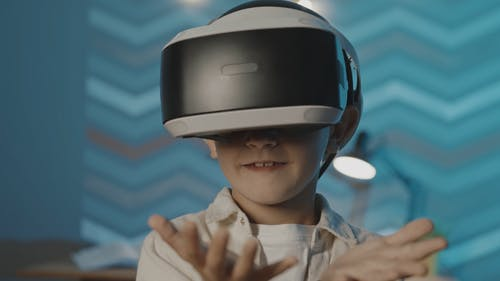 Boy with VR Headset Moving Hands Around