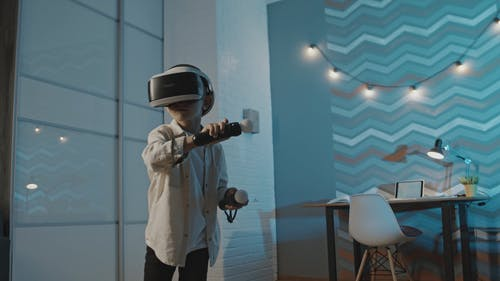 Boy with VR Headset Playing around the Room