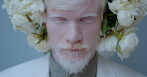Close-Up Shot of a Man Wearing a Flower Wreath