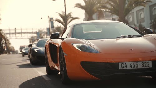 Luxury Sports Cars Passing on the Street