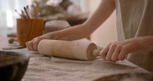Stretching Clay with Rolling Pin