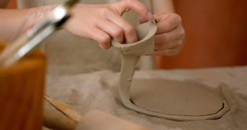 Close up Woman Hands Working with Clay