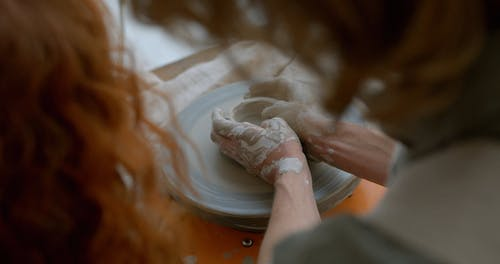 Hands Working with Clay on Potters Wheel