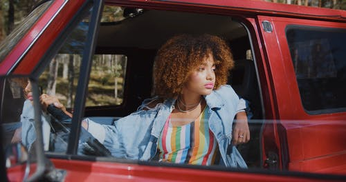 Close up Beautiful Young Woman Sitting in Pickup Truck