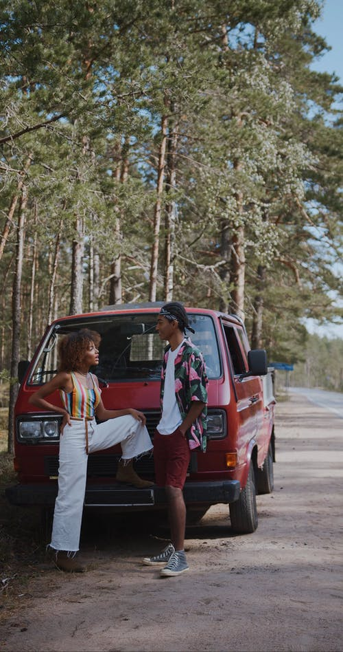 Couple Talking to Each Other While Standing Near Their Pickup Truck