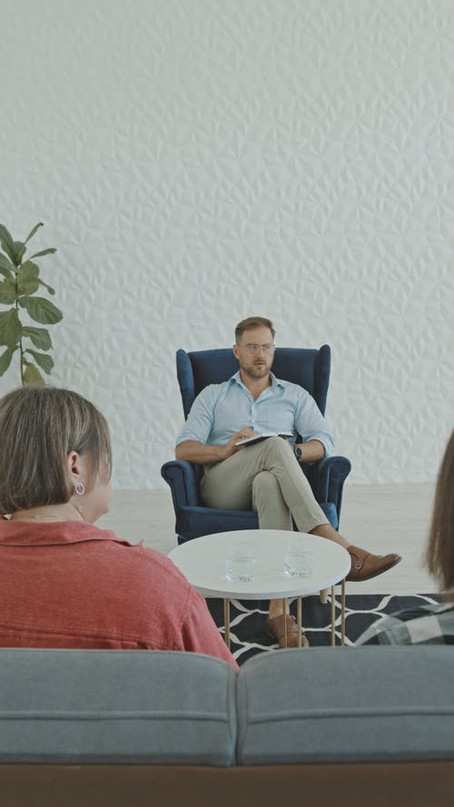Therapist Talking to Patients