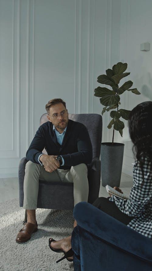 Man Listening to his Therapist