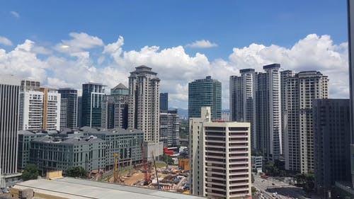 Time-Lapse Video of City Buildings Under White Clouds
