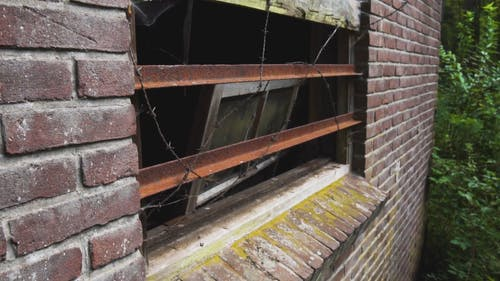 Broken Window of an Abandoned House