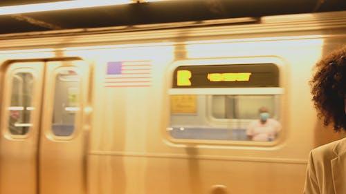 Young Woman Waiting at Subway Platform