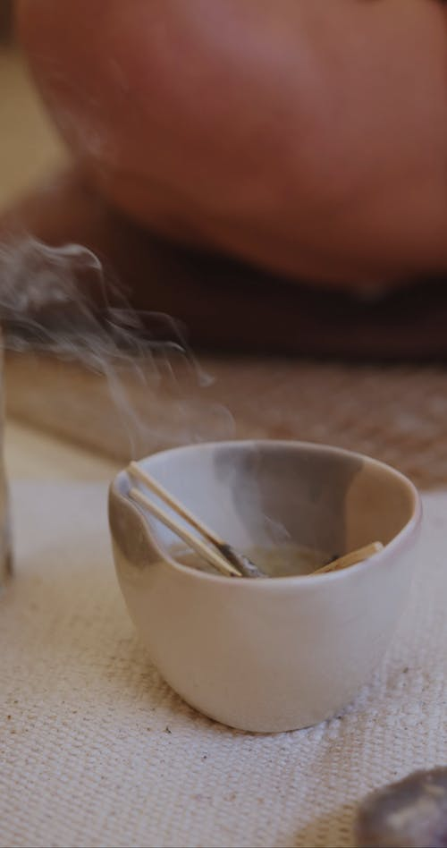 Video of Woman and Burning Incense Sticks