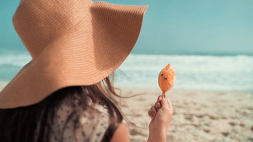 Woman Eating Ice-Cream at the Beach