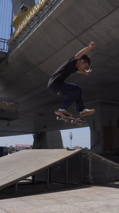 Male Skater Jumping on Ramp