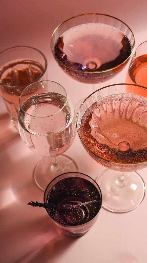 Serving Of Alcoholic Drinks On Crystal Glasses