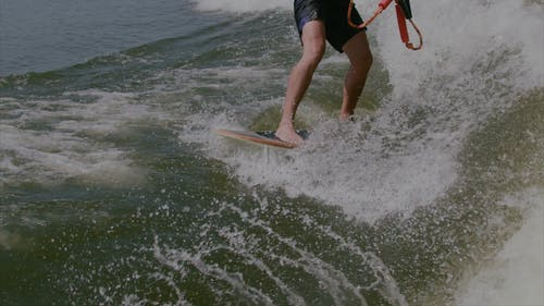 A Person Wakeboarding on Sea