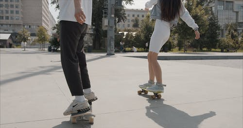 Young People Skateboarding In A Park