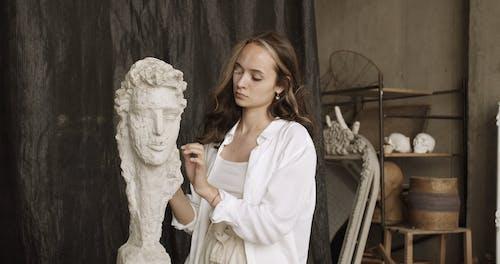 Woman Making Human Sculpture