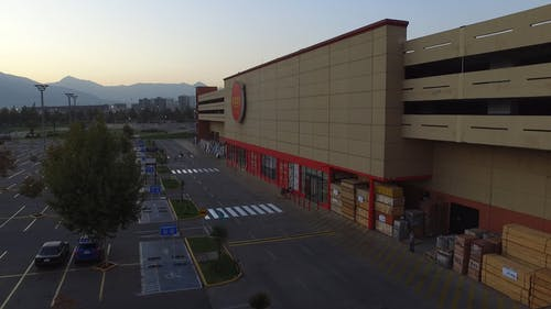 An Aerial Footage of a Commercial Building with a Parking Lot