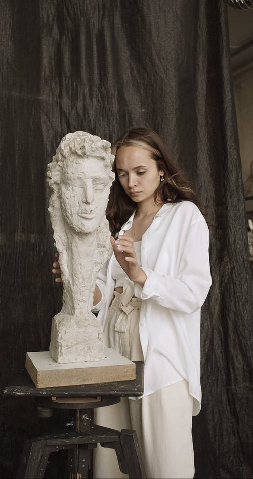 Young Woman Working on Sculpture