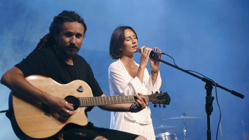 Man and Woman Performing on Stage
