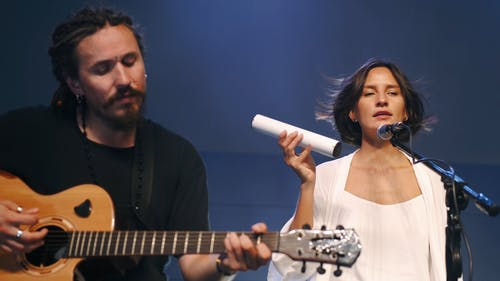 Man and Woman Singing on the Stage