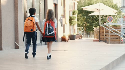 Little Boy And Girl Holding Hands While Walking