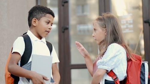 Video Of Children Talking In Front Of The Door