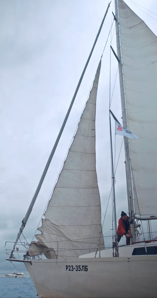 A Man Fixing the Sails of a Boat