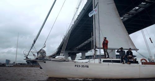 Men on a Sailing Boat