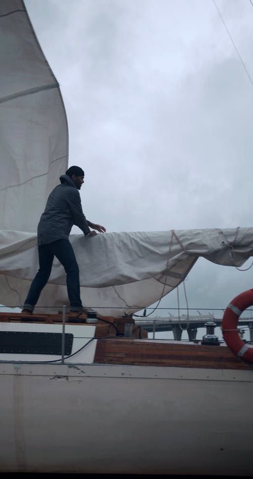 A Man on a Sailing Boat