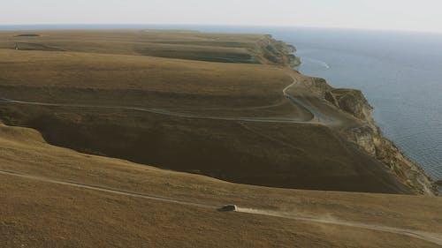 Aerial View Car Driving Along Coastal Road