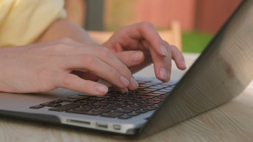 Female Hands Typing on Laptop Close up
