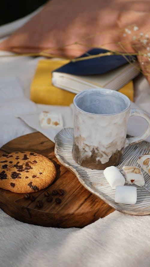 Pouring Black Coffee in a Coffee Mug