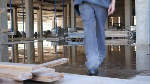 Worker Walking in Construction Site