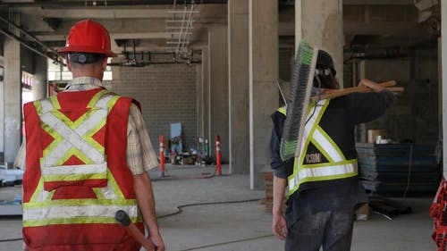 Workers Walking in Construction Site