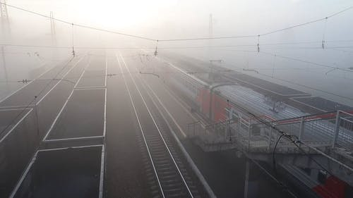 High Angle View of Railway Tracks in Foggy Morning