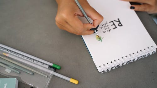 Person Drawing on the Paper