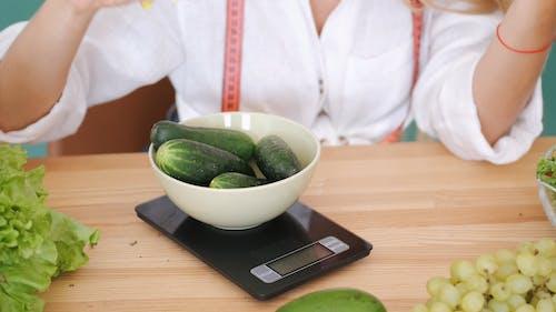 Woman Weighing Vegetables