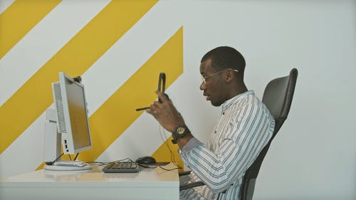 A Man Working In A Call Center