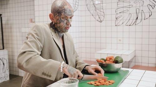 Man Slicing a Carrots