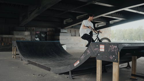 A Man Using His Bike on a Ramp