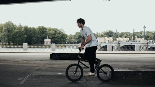A Man Doing a Stunt with His Bike