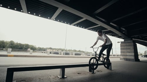 A Man Doing Tricks with His Bike