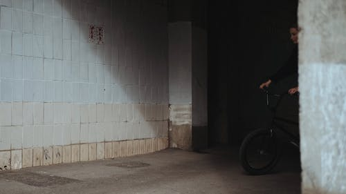 A Woman Doing a Trick with Her Bike